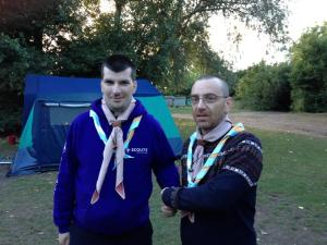 Michael is welcomed into the 1st Gilwell Park Scout Group by his friend Peter.