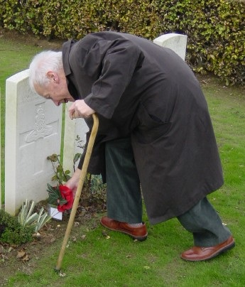 Eighty-seven years since he died, my grandfather W. John Rawles lays a wreath on the grave of his uncle John E. Bovey in the British cemetery in Brebières. Photo: Stephen Rawles.